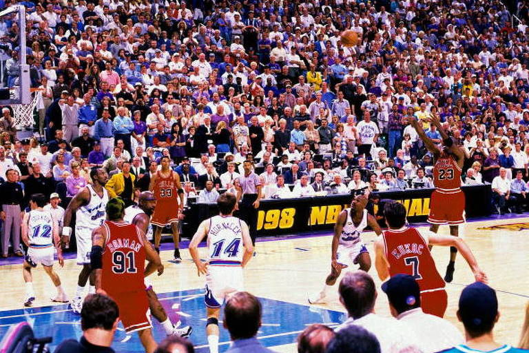SALT LAKE CITY, UT - JUNE 14:  Michael Jordan #23 of the Chicago Bulls hits the game winning shot against the Utah Jazz during Game Six of the 1998 NBA Finals played June 14, 1998 at the Delta Center in Salt Lake City, Utah. The Chicago Bulls defeated the Utah Jazz 4-2 to win the NBA Championship. NOTE TO USER: User expressly acknowledges that, by downloading and or using this photograph, User is consenting to the terms and conditions of the Getty Images License agreement. Mandatory Copyright Notice: Copyright 1998 NBAE (Photo by Fernando Medina/NBAE via Getty Images)