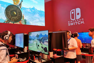 FILE PHOTO: Visitors are seen at a booth of Nintendo Switch at the China Digital Entertainment Expo and Conference, also known as ChinaJoy, in Shanghai