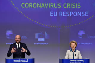 The President of European Commission Ursula von der Leyen and the President of the European Council Charles Michel hold a news conference on the European Union response to the coronavirus disease (COVID-19) crisis at the EU headquarters in Brussels