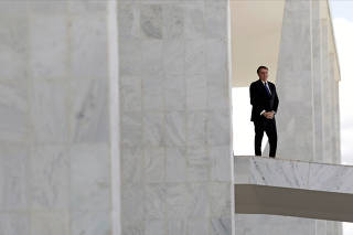 Brazil's President Jair Bolsonaro stands at the ramp of the Planalto Palace, in Brasilia