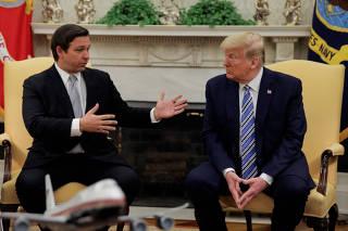 U.S. President Trump meets with Florida Governor DeSantis about coronavirus response at the White House in Washington