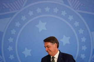 Brazil's President Jair Bolsonaro attends a swearing in ceremony of the new Justice Minister Andre Luiz de Almeida Mendonca, amid the coronavirus disease (COVID-19) outbreak, in Brasilia