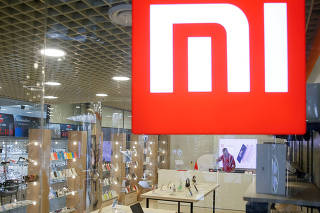 FILE PHOTO: The logo of Xiaomi is seen outside the brand's store in central Kiev