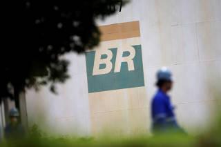A worker walks near a tank of Brazil's state-run Petrobras oil company in Brasilia