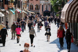 More movement is seen in the streets as the country begins slightly relaxing restrictions, as it prepares a staged end to Europes longest lockdown due to spread of the coronavirus disease (COVID-19), in Venice