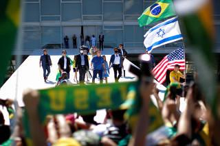 Brazil's President Jair Bolsonaro greets supporters during a protest, in Brasilia