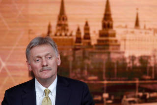 FILE PHOTO: Kremlin spokesman Dmitry Peskov listens during Russian President Vladimir Putin's annual end-of-year news conference in Moscow