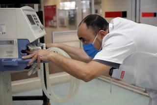 A teacher from the SENAI fixes a damaged respirator, amid the coronavirus disease (COVID-19) outbreak, in Sao Paulo