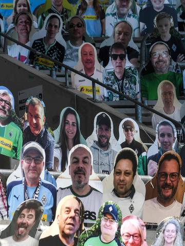 Cardboard cut-outs with portraits of Borussia Moenchegladbach's supporters are seen at the Borussia Park football stadium in Moenchengladbach, western Germany, on May 19, 2020, amid the novel coronavirus COVID-19 pandemic. (Photo by Ina FASSBENDER / AFP)