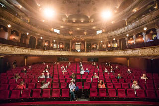 Fewer than 200 audience members attend a concert featuring the baritone Gunther Groissböck and the pianist Alexandra Goloubitskaia at the State Theater of Hesse in Wiesbaden, Germany, which normally seats 1,000, May 18, 2020. (Gordon Welters/The New York Times)