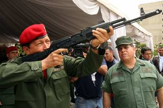 Venezuelan President Hugo Chavez holds a new Kalashnikov assault rifle