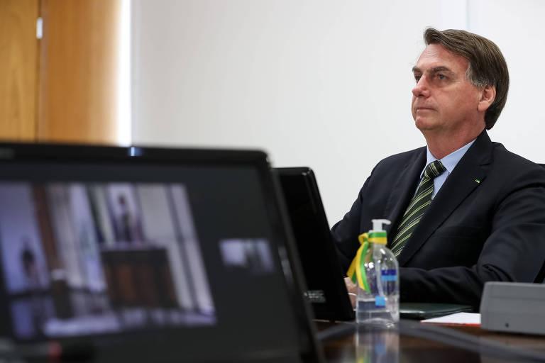 Jair Bolsonaro, participa por videoconferência da solenidade de posse do subprocurador-geral da República Carlos Alberto Vilhena no cargo de procurador federal dos direitos do cidadão nesta segunda (25)