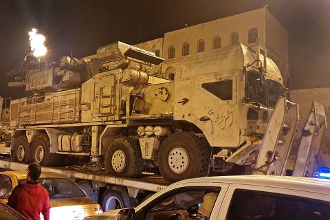Forces loyal to Libya's UN-recognised Government of National Accord (GNA) parade a Pantsir air defense system truck in the capital Tripoli on May 20, 2020, after its capture at al-Watiya airbase (Okba Ibn Nafa airbase) from forces loyal to Libya's eastern-based strongman Khalifa Haftar. - Libya's UN-recognised government scored another battlefield victory on May 18 against strongman Khalifa Haftar, capturing the key rear base used by his fighters in a conflict now in its second year. Haftar, who controls swathes of eastern Libya, launched an offensive in April last year against the capital Tripoli, seat of the UN-recognised Government of National Accord (GNA). (Photo by Mahmud TURKIA / AFP)