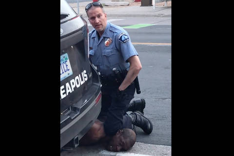 TOPSHOT - This still image taken from a May 25, 2020, video courtesy of Darnella Frazier via Facebook, shows a Minneapolis, Minnesota, police officer arresting George Floyd. -
