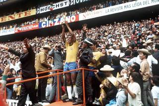 World Cup Final 1970 Mexico City, Mexico. 21st June, 1970. Brazil 4 v Italy 1. Brazilian captain Carlos Alberto holds aloft the Jules Rimet World Cup trophy to thousands of fans in the Azteca Stadium after they defeated Italy in the World Cup Final.