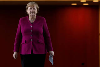 German Chancellor Angela Merkel arrives for a news conference after a meeting with governors of former East German states at the Chancellery following the outbreak of the coronavirus disease (COVID-19) in Berlin