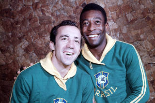 Football. Brazil's Tostao (left) and Pele,stars of the victorious 1970 World Cup winning team in Mexico in happy mood.