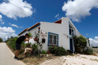 A reporter takes a picture of the house where the suspect lived when Madeleine McCann disappeared in 2007, near Lagos