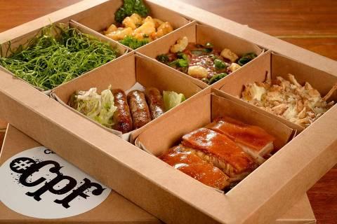 Caixa Prato Feito é novidade da Casa do Porco para o delivery; marmita com o Porco San Zé, carro-chefe do restaurante