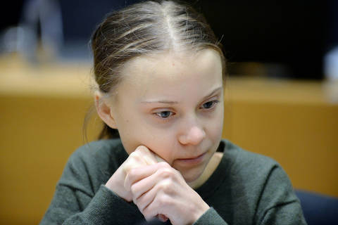 FILE PHOTO: Swedish climate activist Greta Thunberg looks on before the meeting with EU environment ministers in Brussels, Belgium, March 5, 2020. REUTERS/Johanna Geron/File Photo ORG XMIT: FW1