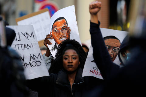 A protester attends a banned demonstration in memory of Adama Traore, a 24-year-old black Frenchman who died in a 2016 police operation which some have likened to the death of George Floyd in the United States, on the Place de la Republique in Lille, France June 4, 2020. REUTERS/Pascal Rossignol ORG XMIT: GDN