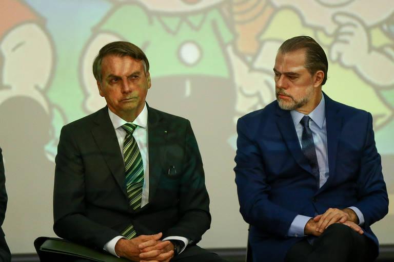 O presidente Jair Bolsonaro acompanhado do presidente do STF, ministro Dias Toffoli, durante seminário sobre combate a corrupção