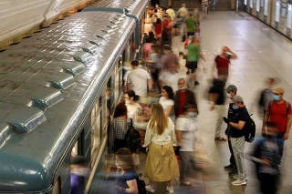 Passengers are seen at a metro station n Moscow