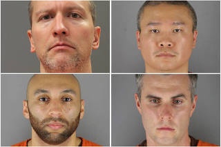 Former Minneapolis police officers pose for booking photographs in Minneapolis