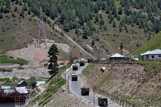 Indian army convoy moves along Srinagar-Leh national highway, at Gagangeer, in east Kashmir's Ganderbal district