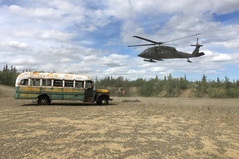 An Alaska Army National Guard UH 60 Blackhawk helicopter hovers near