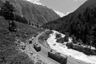 Indian Army convoy moves along a highway leading to Ladakh, at Gagangeer