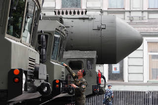 A Russian serviceman cleans a military vehicle before a rehearsal for the Victory Day parade in Moscow