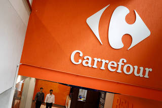 FILE PHOTO: The Carrefour logo is pictured in a supermarket in Sao Paulo