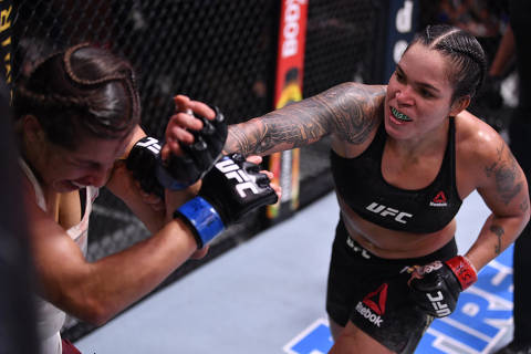 June 6, 2020; Las Vegas, NV, USA; Amanda Nunes of Brazil punches Felicia Spencer of Canada in their UFC featherweight championship bout  during UFC 250 at the UFC APEX.  Mandatory Credit: Jeff Bottari/Zuffa LLC via USA TODAY Sports