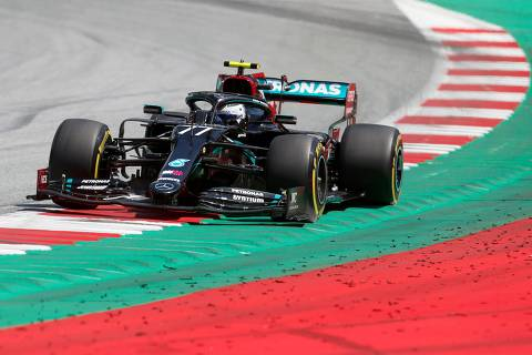 Mercedes' Finnish driver Valtteri Bottas steers his car during the third practice session at the Austrian Formula One Grand Prix on July 4, 2020 in Spielberg, Austria. - Seven months after they last competed in earnest, the Formula One circus will push a post-lockdown 're-set' button to open the 2020 season in Austria on July 5. (Photo by Darko Bandic / POOL / AFP)