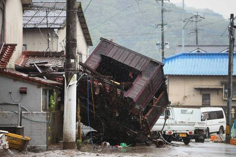 A building structure washed away by flooding due to torrential rain is seen on a street in Hitoyoshi, Kumamoto prefecture on July 5, 2020. - The floods in Kumamoto region on the southwestern island of Kyushu have destroyed houses, swept away vehicles and caused bridges to collapse, leaving many towns submerged and communities cut off. (Photo by STR / JIJI PRESS / AFP) / Japan OUT ORG XMIT: 05AT 42