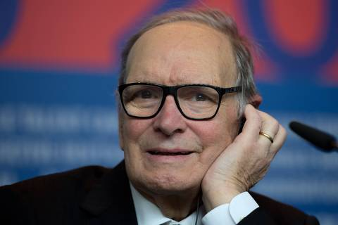 (FILES) In this file photo taken on February 12, 2013 Italian composer Ennio Morricone addresses a press conference for the film