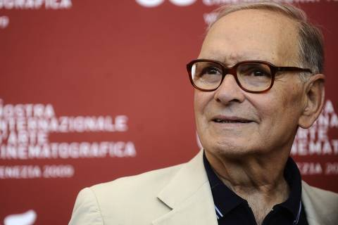 (FILES) In this file photo taken on September 2, 2009 Italian music composer Ennio Morricone poses during the photocall of