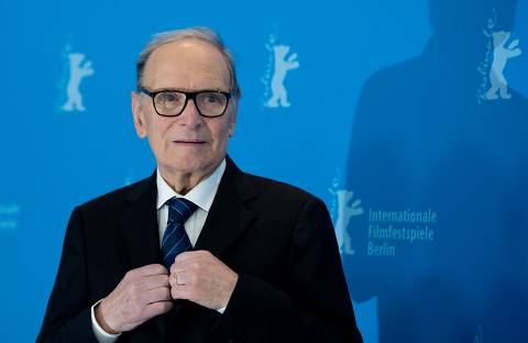 (FILES) In this file photo taken on February 12, 2013 Italian composer Ennio Morricone poses for photographers during a photocall for the film 'The Best Offer' shown in the