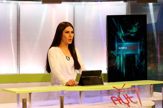 Leonie Dorado, a transgender news anchor, is seen at the TV studio amid the outbreak of coronavirus disease (COVID-19), in La Paz