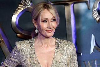 FILE PHOTO: Writer J.K. Rowling poses as she arrives for the European premiere of the film