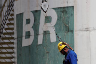 FILE PHOTO: A worker stands near a tank of Brazil's state-run Petrobras oil company in Brasilia