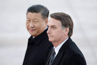 FILE PHOTO: Chinese President Xi Jinping and Brazilian President Jair Bolsonaro attend a welcoming ceremony in Beijing