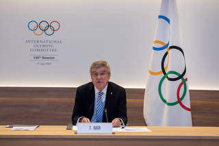IOC President Bach hosts the first ever remote IOC Session in Lausanne
