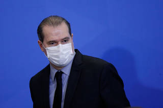 President of Brazil's Supreme Federal Court Dias Toffoli wearing a protective mask attends an inauguration ceremony of the new Communications Minister Fabio Faria (not pictured) at the Planalto Palace, in Brasilia