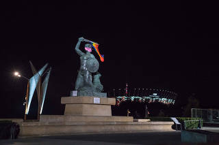 Mermaid of Warsaw statue holds LGBT flag