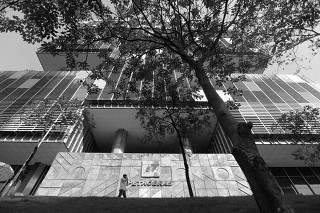 A man walks in front of Brazilian Oil company Petrobras's headquarters in Rio de Janeiro