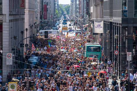 Thousands of demonstrators march down the Friedrichstrasse street as they take part in a demonstration by the initiative
