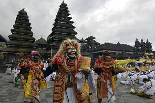 Artists perform Sidakarya mask dancing during mass prayers, expressing gratitude for the handling of the new coronavirus and seeking blessings for the start of a
