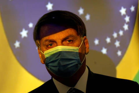 Brazil's President Jair Bolsonaro looks on during the signing ceremony of the